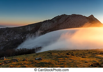 Sunrise at Urkiola over a foggy valley