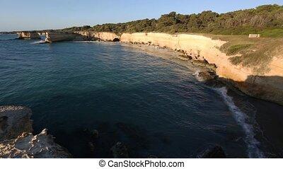 Sunrise beach Spiaggia della Punticeddha, Salento, Italy -...