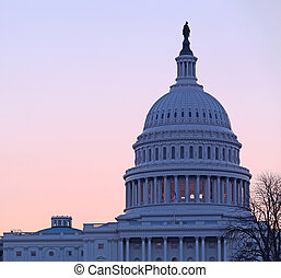 Sunrise behind the dome of the Capitol in DC - Brightly lit...