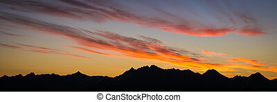 Sunrise clouds and mountain silhouettes