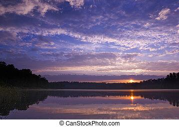 Sunrise. - Colorful sunrise over the lake. Mazury, Poland. ...