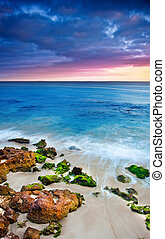 Sunrise Colours - The sun rises over a gorgeous beach with...