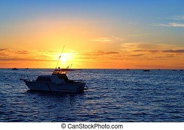 Sunrise fishing boat blue sea orange sky in Mediterranean