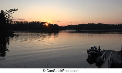 Sunrise Fishing Dock Boat Morning - A 4k clip from Red Lake,...