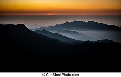 A new day dawns on top of Adam's Peak in Sri Lanka