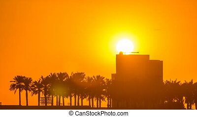 Sunrise from Al Corniche waterfront timelapse in Doha, with...