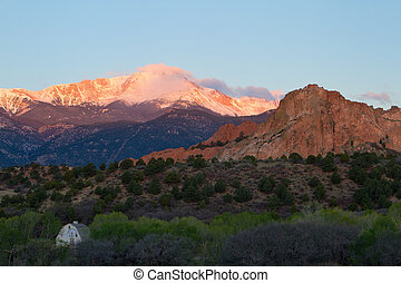 Sunrise glow on Pikes Peak and Garden of the Gods in Colorado Springs
