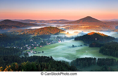 Sunrise in beautiful mountain Czech switzerland with inversion