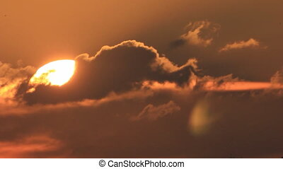 Sunrise in black clouds