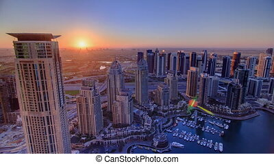 Sunrise in Dubai Marina with towers and harbor with yacht from skyscrapper, Dubai, UAE timelapse 4K