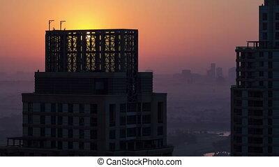Sunrise in Dubai Marina with towers from top of skyscrapper, Dubai, UAE timelapse 4K