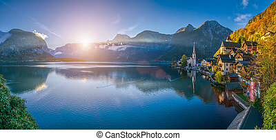 Scenic panoramic picture-postcard view of famous Hallstatt mountain village with Hallstatter See in the Austrian Alps at sunrise in beautiful golden morning light in fall, Salzkammergut, Austria
