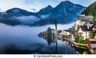 Sunrise in misty Hallstatt