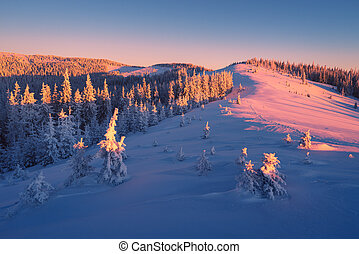 Sunrise in mountains in winter