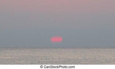 Sunrise in sea, on sea ship floats. Mandatoriccio, Calabria, Italy.