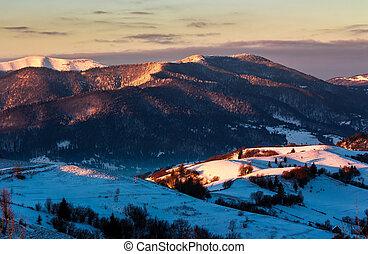 sunrise in snowy Carpathian mountains. beautiful winter...