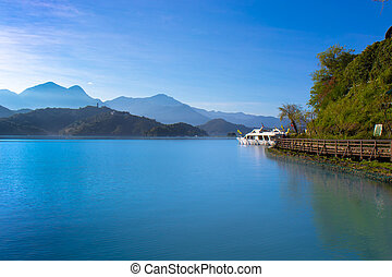 Sunrise in Sun Moon Lake Taiwan with boat