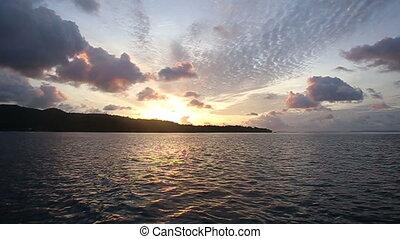 sunrise in the clouds in the ocean