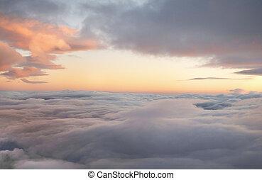 high altitude sunrise in layered cloudscape