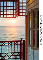 Sunrise in the sea with windows terrace view