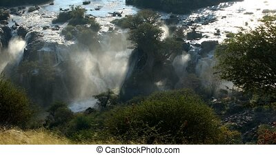 Sunrise in waterfall Epupa Falls, Northern Namibia - Sunrise...