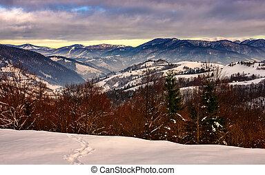 sunrise in winter mountains - mountain peaks in snow on...