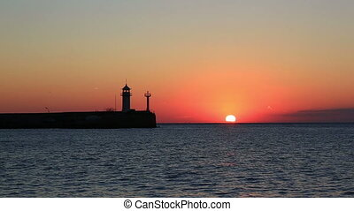 Sunrise in Yalta against a beacon, a view from the central...