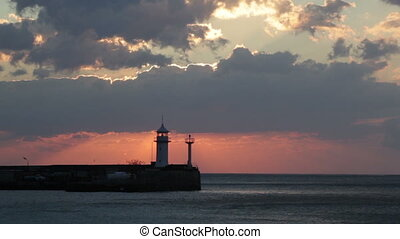 Sunrise in Yalta against a beacon,
