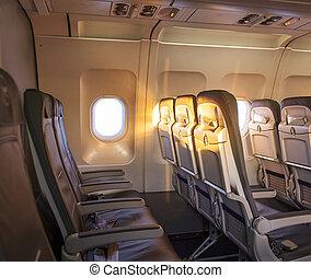 sunrise inside the cabin of a modern aircraft
