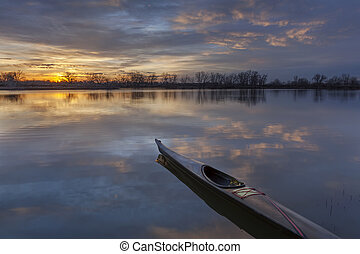 sunrise kayak paddling - a slim sea kayak ready for paddling...
