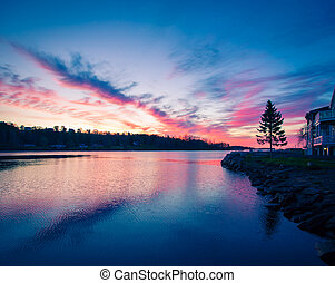 Red morning sky over Mahone Bay in Nova Scotia