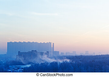 sunrise mist and blue and pink sky over city