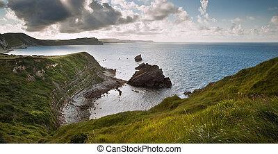 Beautiful sunrise landscape over Mupe Bay on Jurassic Coast in Dorset, England