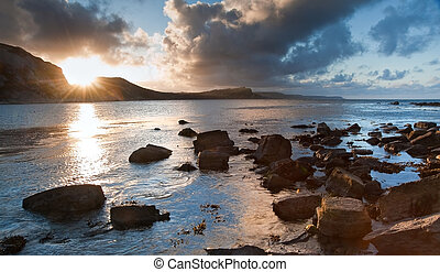 Sunrise ocean landscape Mupe Bay Jurassic Coast England -...