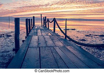 Sunrise of a wooden pier