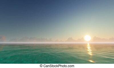 Sunrise on a calm ocean and blue sky