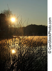 Sunrise on a lake at spring