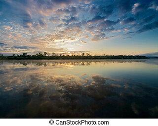 Sunrise on a river. - Sunrise on a river