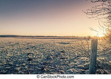 Sunrise on a rural countryside in the winter
