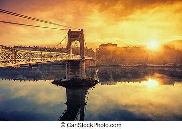 Sunrise on footbridge in Lyon city in France