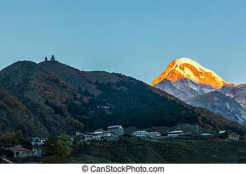 Sunrise on Kazbek mountain in Kazbegi, Georgia