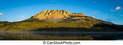 Beautiful sunrise illuminating Beartooth Butte and Lake in Montana