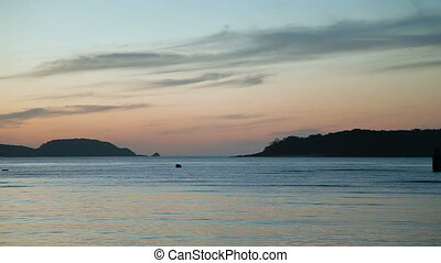 Sunrise on Phuket island, Thailand. Seascape at early morning on Rawai beach.