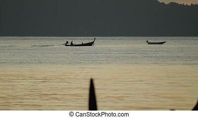 Sunrise on Phuket island Thailand. Seascape with fishers boats. Early morning on Rawai beach.