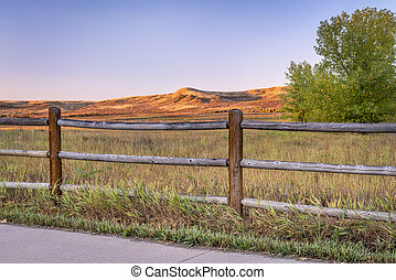 sunrise on the Poudre River Trail in northern Colorado near Windsor. It is a paved bike trail extending more than 20 miles between Timnath and Greeley.