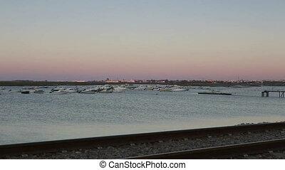 Sunrise on Ria Formosa view of Faro airport.