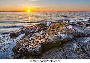 Sunrise On Rocky Shore