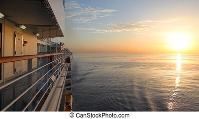 sunrise on sea, view from moving cruise ship