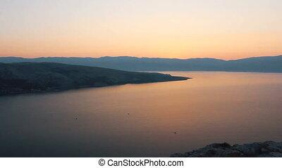 Sunrise on sea with hills, Croatia
