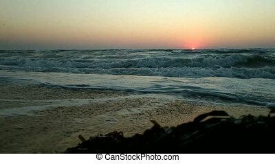 Colorful sunrise on seashore.